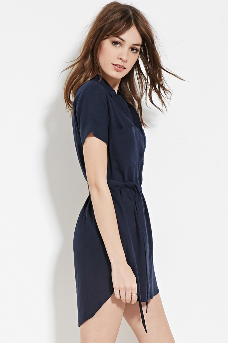 5b3562fca0 A cuffed short-sleeved mini shirt dress crafted from a linen-blend woven  with a buttoned front
